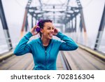 portrait of a happy athlete... | Shutterstock . vector #702816304