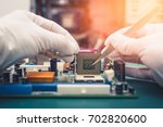the technician putting a cpu in ... | Shutterstock . vector #702820600