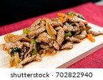 wok fried pork stir fry with... | Shutterstock . vector #702822940