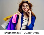 stylish woman with shopping... | Shutterstock . vector #702849988