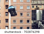 a flying car in a city | Shutterstock . vector #702876298