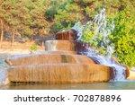 travertine deposits around the... | Shutterstock . vector #702878896