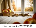 wooden old table in an autumnal ... | Shutterstock . vector #702879538