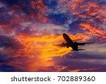 silhouette passenger airplane ... | Shutterstock . vector #702889360