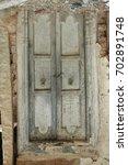 old wood door at rural house | Shutterstock . vector #702891748