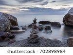 stones balanced on a rock  on... | Shutterstock . vector #702898984