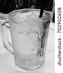 plain iced water | Shutterstock . vector #702902608
