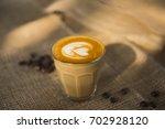 glass of coffee in coffee shop | Shutterstock . vector #702928120