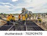 construction worker concrete... | Shutterstock . vector #702929470