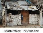 rural village poor house | Shutterstock . vector #702936520