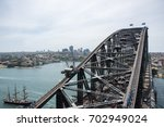 tall ship and harbour bridge... | Shutterstock . vector #702949024