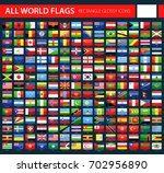 glossy flag icons on dark... | Shutterstock .eps vector #702956890