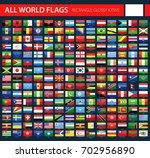 glossy flag icons on dark... | Shutterstock .eps vector #702956890
