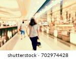abstract blur shopping mall...   Shutterstock . vector #702974428