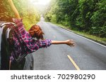 asian women travel relax in the ... | Shutterstock . vector #702980290