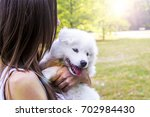 happy woman playing in the park ... | Shutterstock . vector #702984430