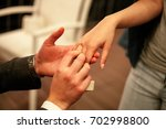 man makes woman marriage... | Shutterstock . vector #702998800