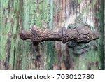 beautiful old door handle     | Shutterstock . vector #703012780