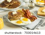 healthy full american breakfast ... | Shutterstock . vector #703014613