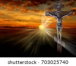 silhouette of the crucified... | Shutterstock . vector #703025740