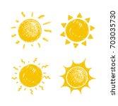 hand drawn crayon sun set   Shutterstock .eps vector #703035730