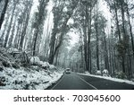 snow on roads and forest on... | Shutterstock . vector #703045600