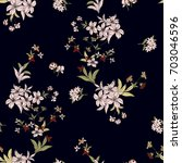 seamless floral pattern in... | Shutterstock .eps vector #703046596