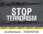 stop terrorism and trace of... | Shutterstock .eps vector #703050700