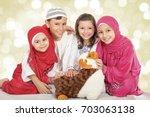 happy little muslim kids... | Shutterstock . vector #703063138