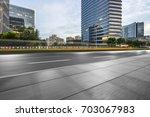 empty asphalt road front of... | Shutterstock . vector #703067983