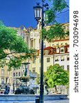 Small photo of LISBON, PORTUGAL - CIRCA SEPTEMBER 2012: Park with a fountain and ornate street light adjacent to the Carmo Convent