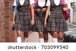 female students school uniforms ... | Shutterstock . vector #703099540