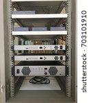 audio equipment in rack. | Shutterstock . vector #703101910