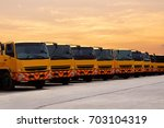 new truck fleet is parking at... | Shutterstock . vector #703104319