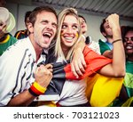 german couple supporting the...   Shutterstock . vector #703121023
