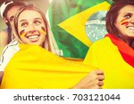female supporters from... | Shutterstock . vector #703121044