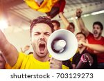 german fan shouting with... | Shutterstock . vector #703129273