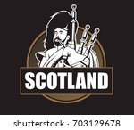 player of the great scottish... | Shutterstock .eps vector #703129678