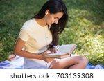 top view of caucasian brunette... | Shutterstock . vector #703139308