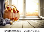 old wooden table by the window... | Shutterstock . vector #703149118
