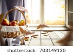 old wooden table by the window... | Shutterstock . vector #703149130