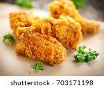 fried chicken wings on wooden... | Shutterstock . vector #703171198