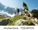 trail running adventure in the... | Shutterstock . vector #703189510