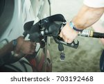 man hand filling car with... | Shutterstock . vector #703192468