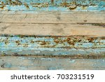 the texture of the wood of the... | Shutterstock . vector #703231519
