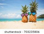 couple of attractive pineapples ... | Shutterstock . vector #703235806