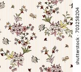 seamless floral pattern in... | Shutterstock .eps vector #703258204