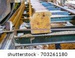 sawmill. process of machining... | Shutterstock . vector #703261180