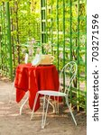 chair and table covered with a... | Shutterstock . vector #703271596