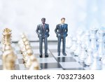 two toy businessmen  lawyers or ... | Shutterstock . vector #703273603
